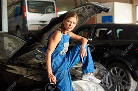 Black Car With An Open Hood And A Female-mechanic Sitting On ...