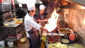 The Heat of the Indo-Chinese Wok Master's Kitchen on a Very Busy ...
