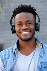 Close Up Cool Young Black Guy Listening To Music With Headphones ...