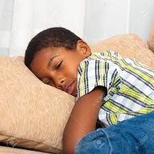 Close Up Of Cute Tired Child Boy Sleeping On Sofa. Stock Photo, Picture And  Royalty Free Image. Image 16960148.