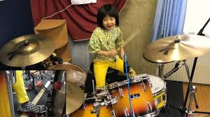 8-year-old girl stuns playing 'complicated' Led Zeppelin song on drums -  National | Globalnews.ca