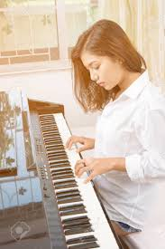 Beautiful Asian Woman Playing Piano Stock Photo, Picture And Royalty Free  Image. Image 68225263.